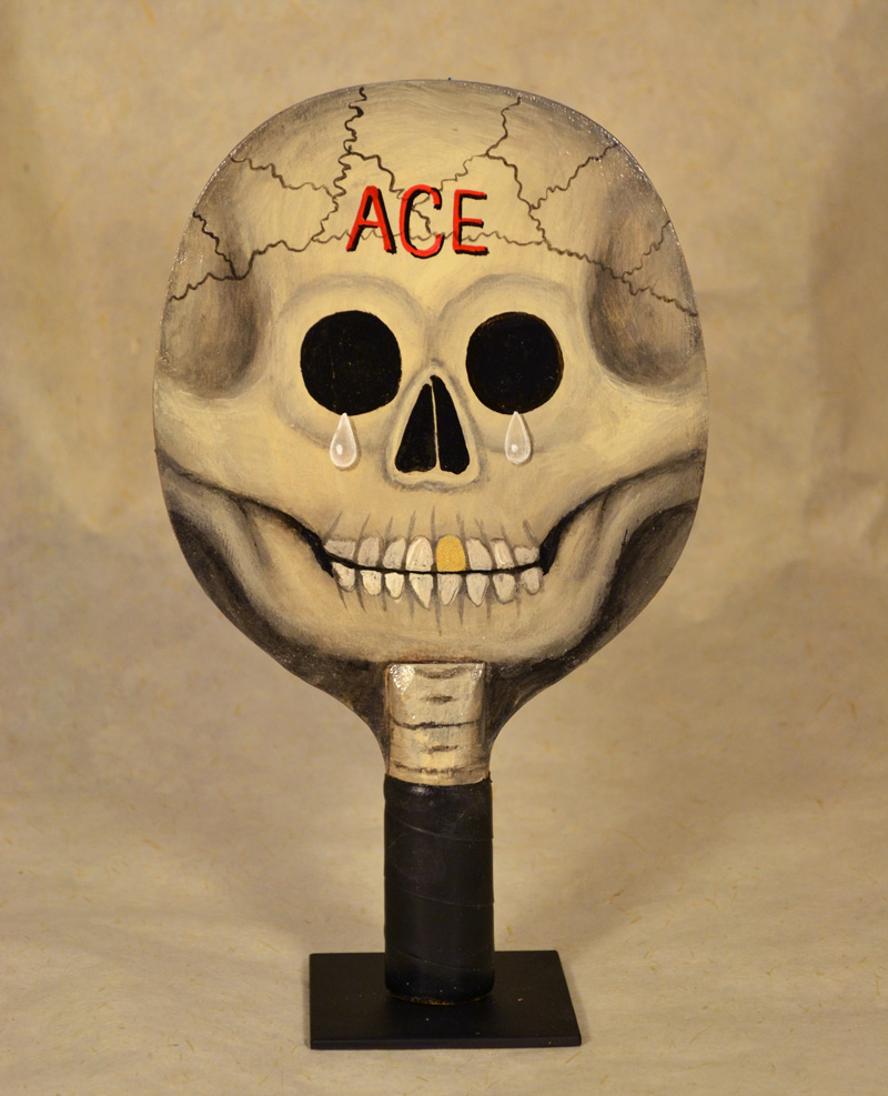 Fred Stonehouse, Skull paddle (ACE), 2018, acrylic on vintage ping-pong paddle. 26×16,5 cm