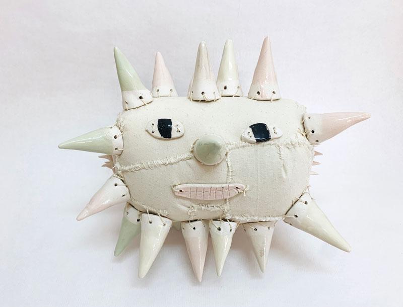 Lusesita, Star with face, 2021, handpainted ceramic and fabrics, h 31 x 33 x 31 cm